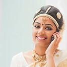 Portrait of a bride talking on a mobile phone