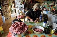 Woman making homemade sausages