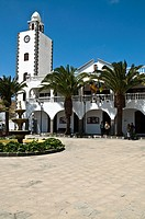 SAN BARTOLOME LANZAROTE Clock tower white building and village plaza square