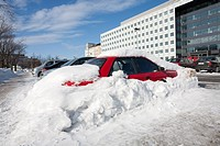 red car buried in snow Helsinki Finland