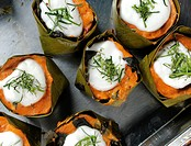 Hor Mok steamed red curry cake with fish or mixed seafood in banana leaf bowl , made with red curry paste , Thai spices , a mixed of seabass & snake h...
