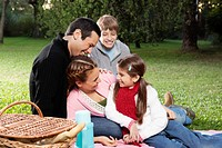 Family enjoying at a picnic in a park