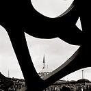 Islamic minaret contrasts with modern art in Istanbul, Turkey.