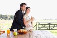 Couple standing near a breakfast table