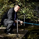 Businessman fly_fishing in a river