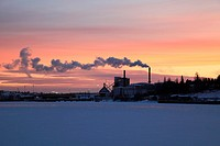 Power plant at sunset, situated on the banks of a frozen bay of the Baltic Sea in Sweden