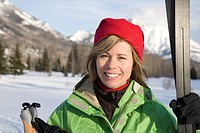 Woman at trailhead of cross_country ski trails.