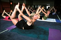 Blond woman in a yoga class in Park City, Utah.