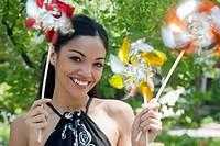 Young Woman Holding Pinwheels