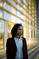 Businesswoman looking away in thought, portrait (thumbnail)