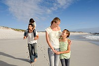 Familly walking on beach