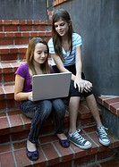 Middle school girls using laptop