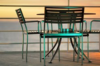 Tables and chairs on a cruise ship in mixed light, Sunset and Fluorescent