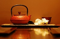 Japanese tea set with flowers is reflected in the table