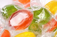 Close up view of assorted hard candy in cellophane wrappers