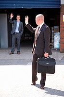 Businessman waving goodbye after meeting