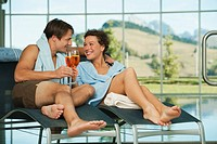 Italy, SouthTyrol, Couple enjoying drink in hotel urthaler