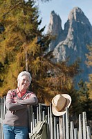 Italy, South Tyrol, Mature woman hiking at dolomites