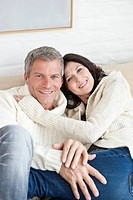 Germany, Munich, Mature couple smiling, portrait