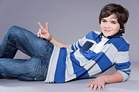 Boy showing peace symbol, portrait