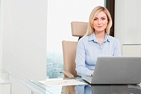 Germany, Frankfurt, Business woman using laptop, portrait