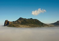 View of mist shrouded coastal mountain, The Sentinel, Hout Bay, Cape Town, Western Cape, South Africa