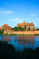 Malbork Castle is located on Southeastern bank of the river Nogat in Pomerania, Poland It was built by the Teutonic Order as an Ordensburg and named M...