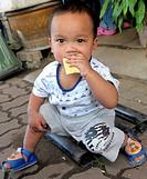 baby eating durian fruit, klong toey market klong toei , bangkok, thailand