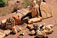 Religious statues are broken because of the work for the dried lake