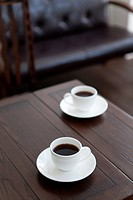Two Coffees on Wooden Table
