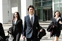 Businesspeople coming out of the office, Tokyo Prefecture, Honshu, Japan