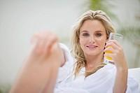 Portrait of a woman drinking orange juice