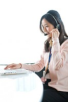 Businesswoman on headsets, Tokyo Prefecture, Honshu, Japan