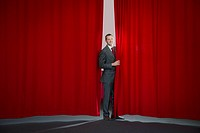 Man Standing by Theatre Curtain