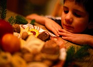 child looking dreamingly at a plate filled with Christmas savouries