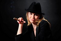 Girl in a hat with a cigar