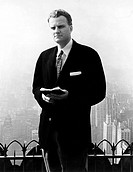 Billy Graham . Evangelist with Bible in publicity for NYC Crusade in Madison Sq.Garden,6/1/57