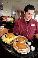 Florida, Miami, Hialeah Gardens, Denny's Restaurant, Hispanic, man, waiter, service, serving, food, pancakes