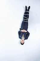 businessman dangling from the above