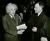 Albert Einstein 1879_1955, receiving his certificate of American citizenship. Einstein left his native Germany after the Nazis came to power in 1933