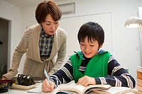 Mother Serving Snack for Son Studying