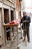 disabled blind man buying meat from street butcher , the nepalis , life in kathmandu , kathmandu street life , Nepal