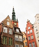 Townhouses in old town of Gdansk with tower of old town hall in the background