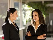 Hispanic businesswomen talking together