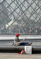 A lonely woman is reading a book in Louvren, Paris