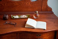 Diary and spectacles on dressing table