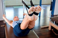 Woman doing pilates in gym