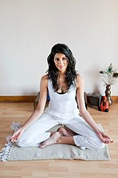 Women in lotus position during yoga