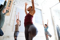 Women practicing yoga (thumbnail)