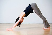 Woman in downward facing dog position during yoga
